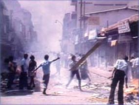 Sinhala mob set fire to Tamil shops July 1983