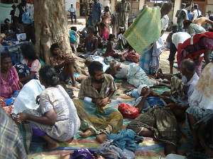 People at a makeshift hospital in Putumattalan that was treating survivors of attacks on April 8 and 9, 2009. Many were women and children who were waiting in a food distribution line in Pokkanai when artillery shells hit.