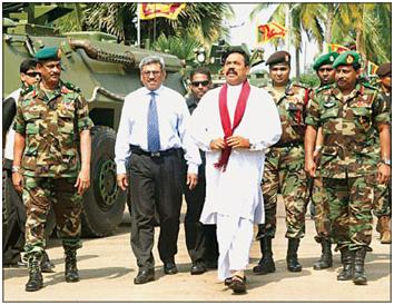 Defence Secretary Gotabhaya Rajapaksa (in blue tie) with his elder brother and President Mahinda Rajapaksa. On to his right was General Sarath Fonseka in 2009. (Photo from Colombo Daily News, May 22, 2009).