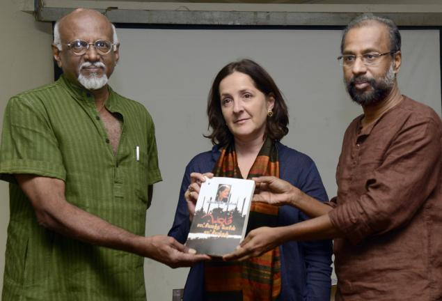 Poet Cheran (right) handing over the first copy of the Tamil version of Frances Harrison's book to art critic Sadanand Menon (left) at a function in Chennai on Saturday. Photo: R.Ravindran
