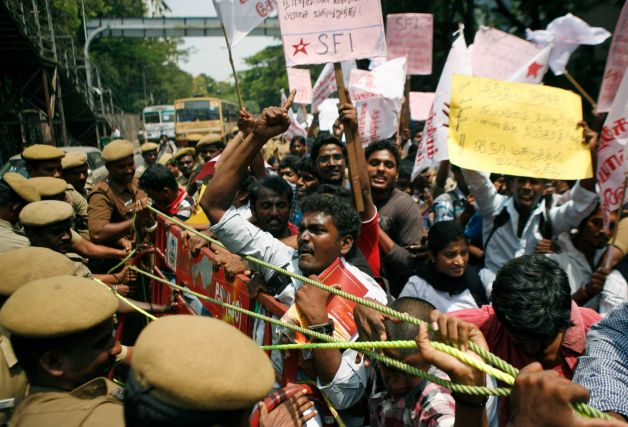 Indian Tamil activists and students shout slogans while trying to push past a barricade during a protest against Sri Lanka's alleged wartime abuses, in Chennai, India, Tuesday, March 19, 2013. A key ethnic Tamil political party withdrew from the ruling Indian government Tuesday over its unmet demands that India amend the U.N. resolution to declare that Sri Lanka committed genocide against its minority Tamil population during the final months of its civil war against the Tamil Tiger rebels. Photo: Arun Sankar K.