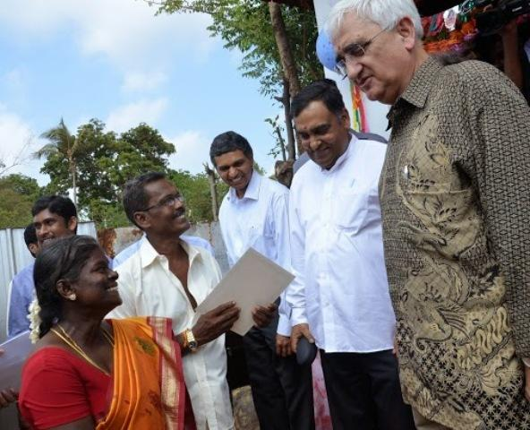 External Affairs Minister Salman Khurshid with beneficiaries of the Indian housing project near Jaffna on Tuesday. India's High Commissioner to Sri Lanka Y.K. Sinha and Deputy High Commissioner P. Kumaran are in the picture. Photo: Meera Srinivasan.