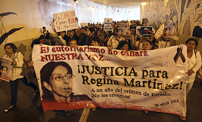 Journalists protest the one-year anniversary of the murder of journalist Regina Martínez Pérez. Anti-press attacks are so common that Mexican authorities passed a bill authorizing federal authorities to prosecute crimes against journalists. (AP/Felix Marquez)