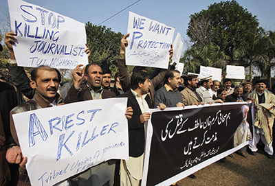 Pakistani journalists protest the killing of their colleague in January 2012. (AP/Mohammad Sajjad)