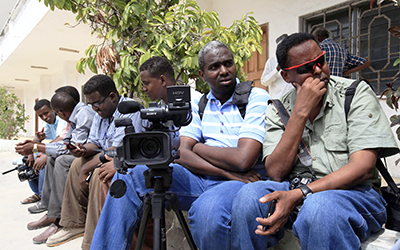 The press faces increasing risks while reporting in Somalia. Here, journalists wait during an assignment outside the presidential palace. (Reuters/Feisal Omar)
