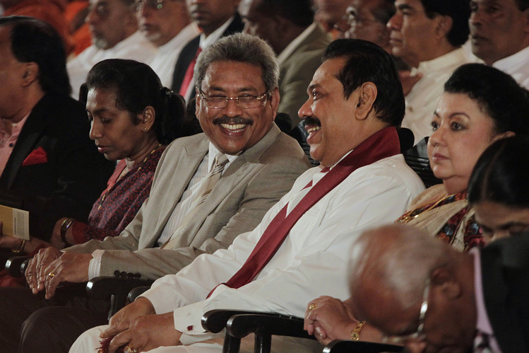 BROTHERLY LOVE: President Mahinda Rajapaksa (in white and wearing a scarf) rules the country with his son and two brothers, including Defense Secretary Gotabhaya Rajapaksa (to his right), and assorted members of the Rajapaksa clan.