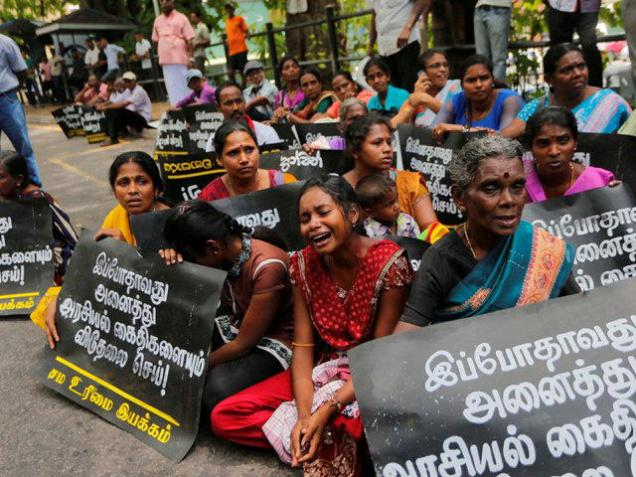 Family members of ethnic Tamil detainees sit for a silent protest in Colombo, Sri Lanka, Wednesday, Oct. 14, 2015. hindu