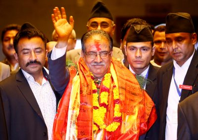 Nepal's newly elected Prime Minister Pushpa Kamal Dahal waves towards the media after he was elected Nepal's 24th prime minister in 26 years, in Kathmandu, Nepal, 3 August, 2016. (Photo: Reuters/Navesh Chitrakar).