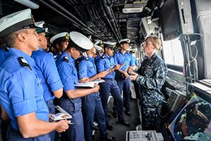 Lt. j.g. Jill Carnahan conducts a ship tour with Sri Lanka Navy sea cadets aboard the amphibious transport dock ship USS Somerset (LPD 25) during a theater security cooperation exchange with the Sri Lankan military, Nov. 24, 2016. Somerset and embarked 11th Marine Expeditionary Unit are conducting the exchange with Sri Lankan forces in order to enhance tactical skill sets and disaster relief capabilities while strengthening the overall relationship between the two forces